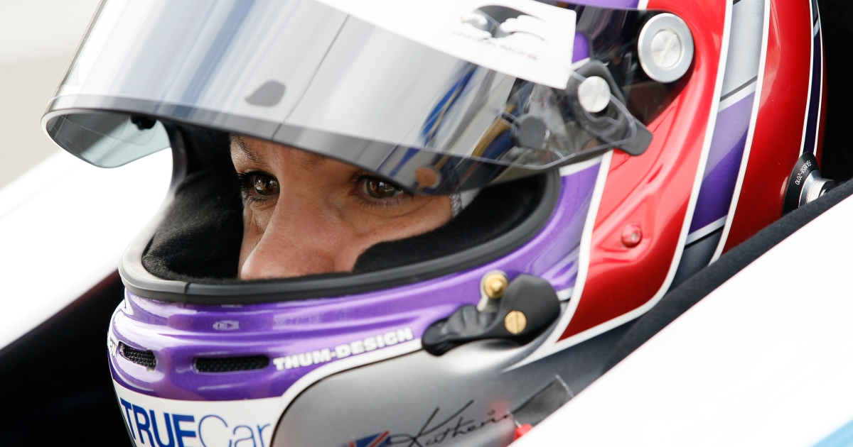 BIRMINGHAM, AL - MARCH 30: Katherine Legge of England, driver of the #6 Lotus-Dragon Racing Lotus, waits in the pits during practice for the IndyCar Series Honda Indy Grand Prix of Alabama presented by Legacy at Barber Motorsports Park on March 30, 2012.</p>