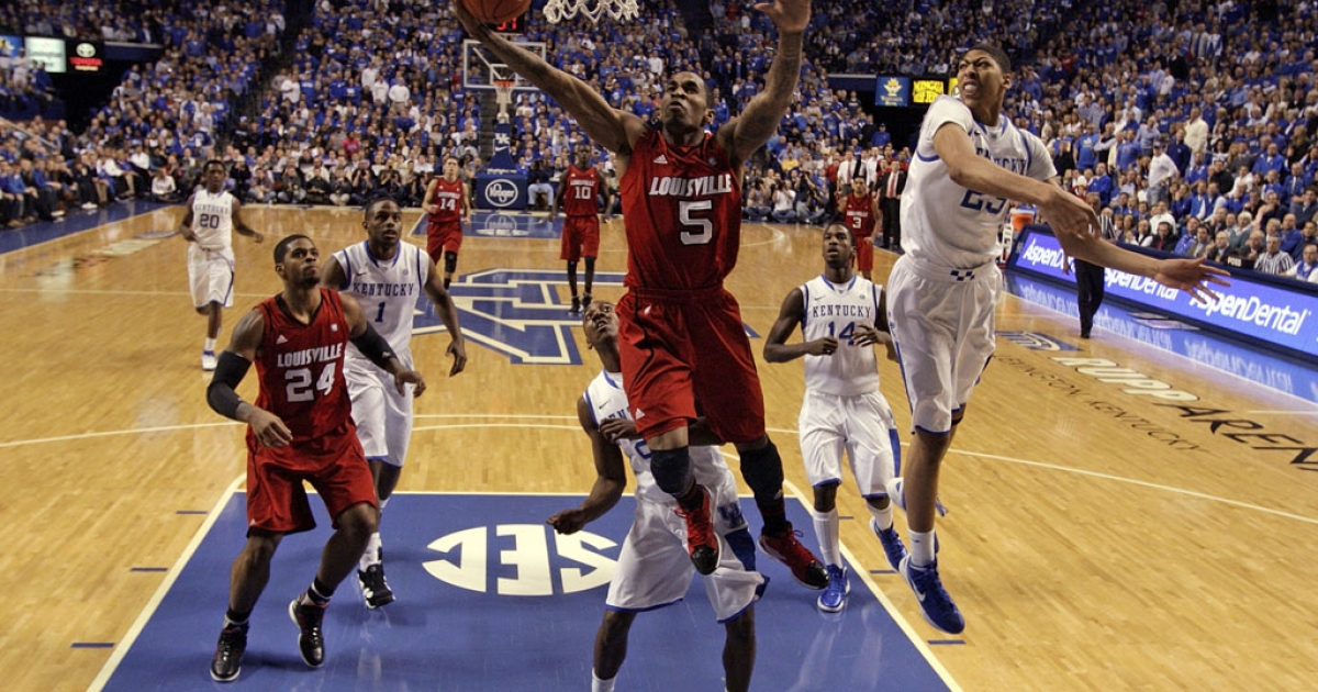 Louisville Cardinals' Chris Smith shoots during a 69-62 loss to the Kentucky Wildcats at Rupp Arena on Dec. 31, 2011, in Lexington, Ken. The storied rivals meet again tonight with a berth in the national championship Final Four on the line.</p>