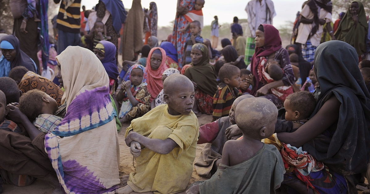 Somali refugees, displaced from their homes in southern Somalia by a famine that is ravaging the horn of Africa region, wait at a registration center at the Dagahaley refugee site on Aug. 2, 2011.</p>