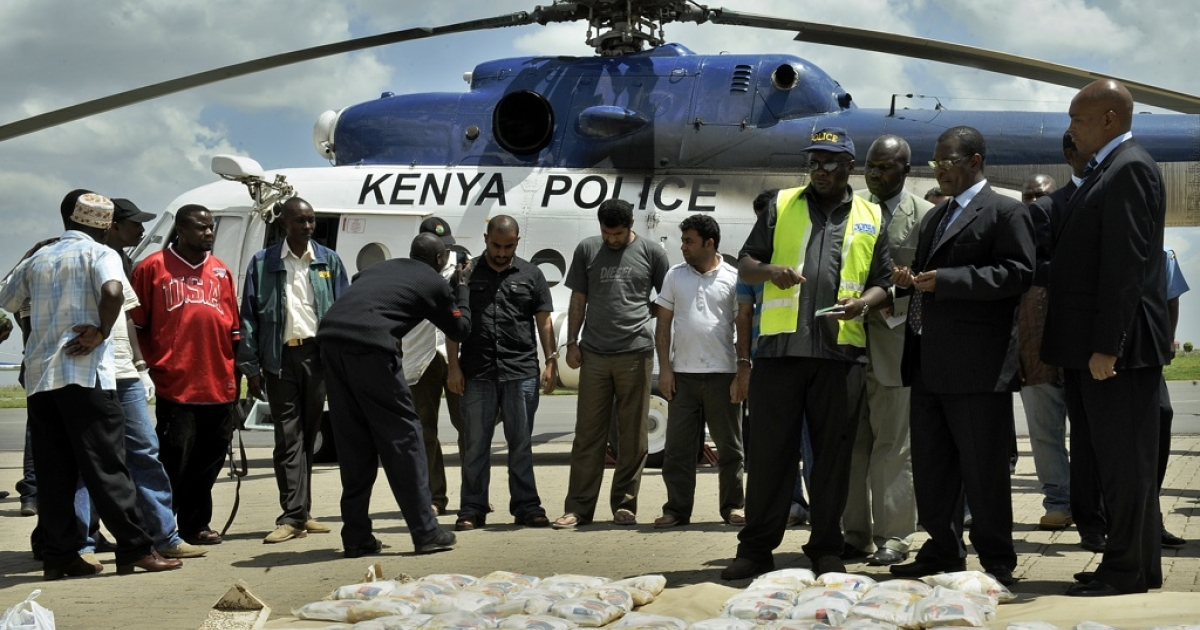 Kenya has become a hub for the international drug trade, according to a new U.S. report. Here six suspects arrested in Mombasa stand behind 432 pounds of heroin in bags seized by Kenyan police.</p>
