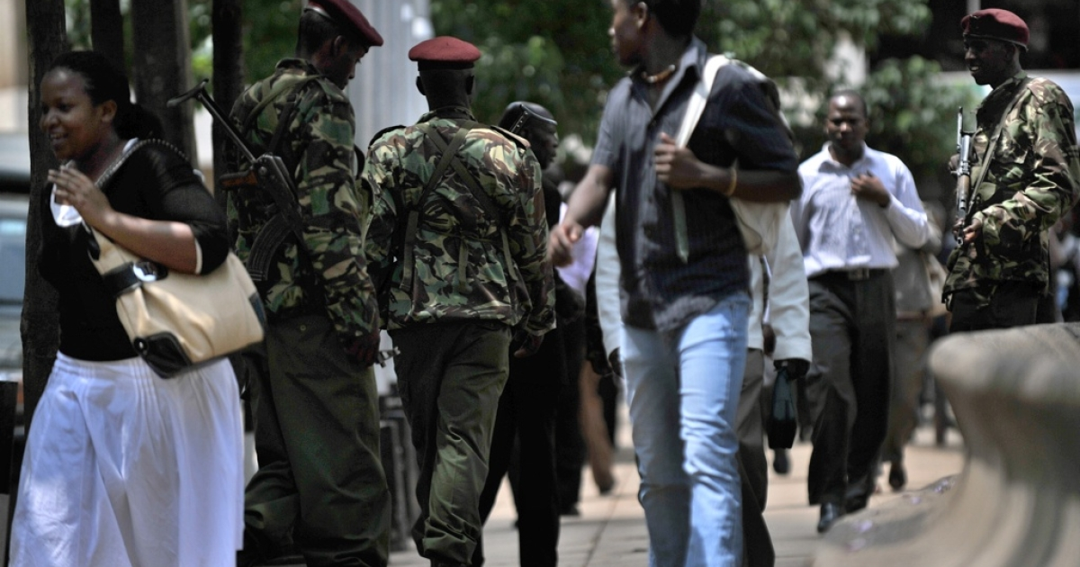 Members of Kenya's General Paramilitary Service Unit patrol on the streets of Nairobi on October 24, 2011 following two grenade attacks on a local pub and a bus stop that together, killed one and wounded some 32 people. Police blame the grenade attacks on the Somali rebels, Al Shabaab.