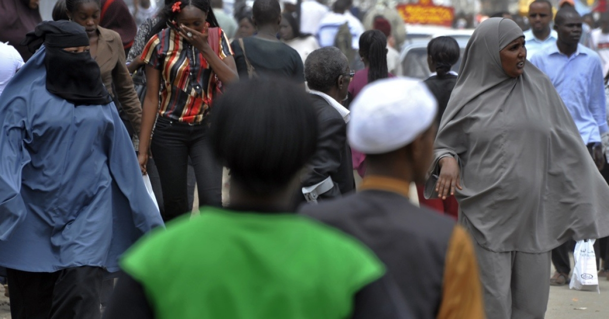 Residents of Eastleigh, a Nairobi neighborhood known for its Somali immigrant population, walk on January 18, 2010 in a commercial street.</p>