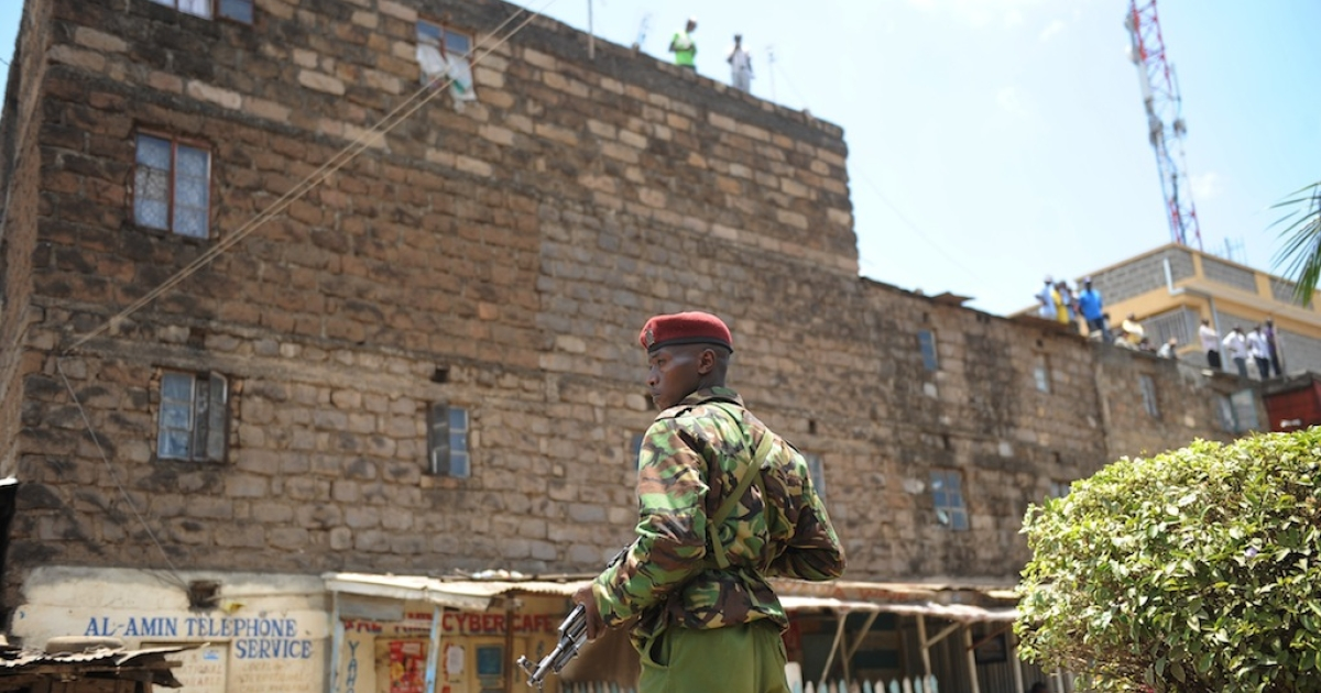 A policeman stands guard next to the site where a blast ripped through a church in Nairobi on September 30, 2012.</p>