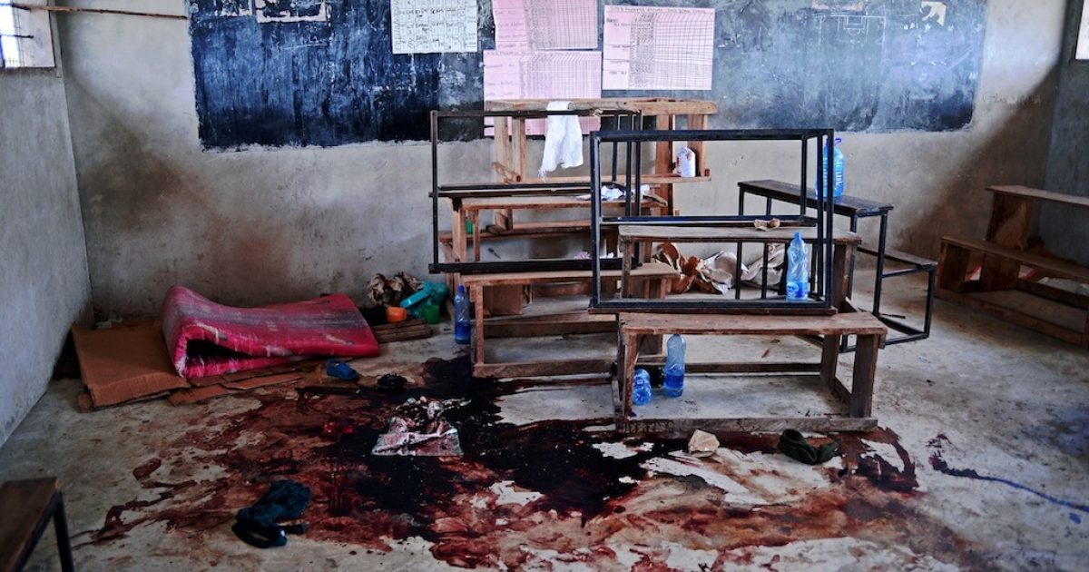 Blood stains the floor of a classroom in Kilelengwani village in the Tana river Delta on September 12, 2012. Orma tribe villagers and the Red Cross claim 8 children were slaughtered in the classroom by members of the Pokomo tribe during an attack by 300 tribesmen on the village which left 38 people dead,167 houses burnt to the ground, and scores of slaughtered cattle. The Kenyan government has authorised a deployment of 1,300 General Service Unit (GSU) officers, the Kenyan specialist riot police squad, in the area and a dusk to dawn curfew, after 112 people were killed in clashes between the Pokomo and Orma tribes since late August 2012.</p>