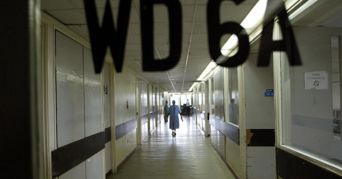 A Kenyatta National Hospital volunteer walks through the empty corridors of the country's biggest hospital.</p>