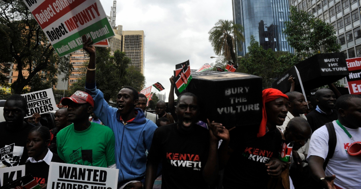 The Kenyan public protests corruption in Parliament June 28, 2012 in Nairobi, Kenya. The Kenyan Parliament has become notorious for its excess.</p>