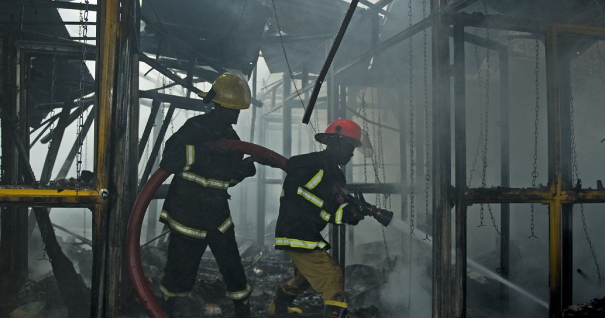 Firefighters extinguish a fire at the site of a blast in central Nairobi on Moi Avenue on May 28, 2012. A large blast that wounded dozens of people in the center of the Kenyan capital was labeled as a