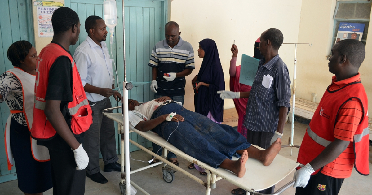 A man is stretchered as he arrives at the Garissa General Provincial Hospital, close to the border with Somalia, on November 4, 2012 after a grenade attack on a Kenyan church that left one policeman dead and 14 other people wounded. Kenya has seen a wave of grenade attacks on cities including the capital Nairobi and the key port of Mombasa since the country sent troops into Somalia in October last year to fight Al-Qaeda-linked Shebab insurgents.</p>