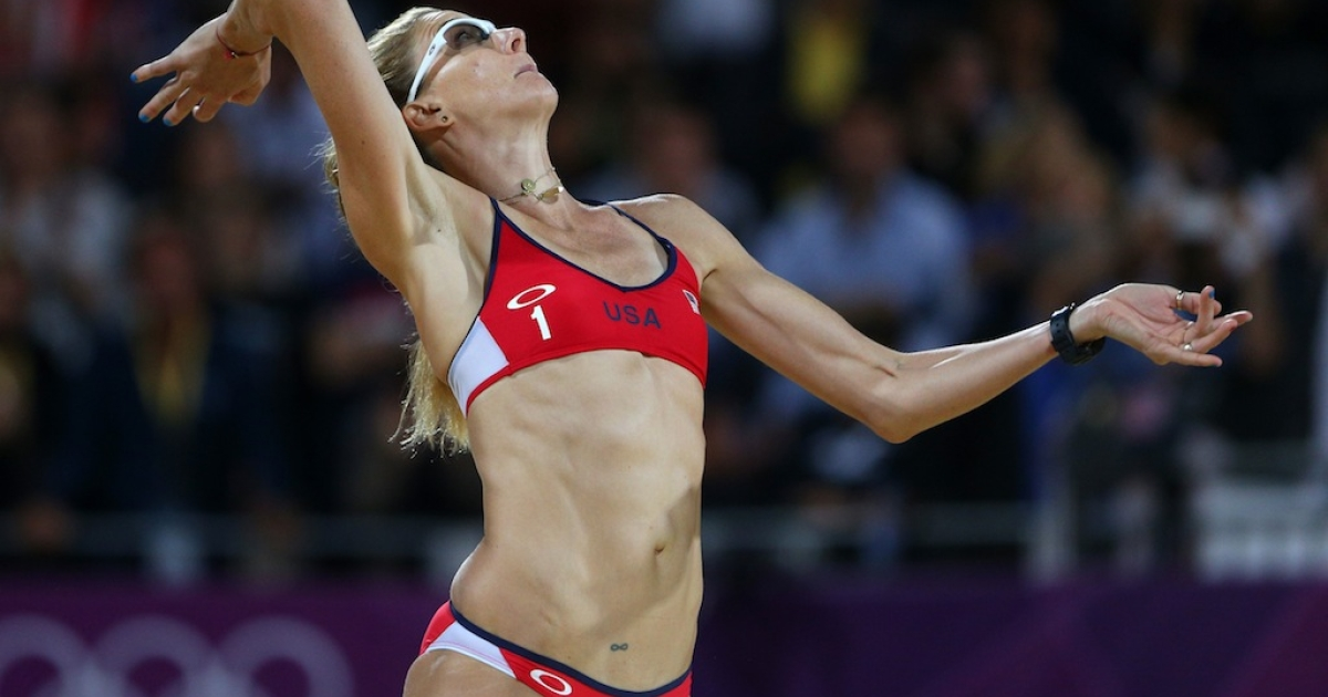 LONDON, ENGLAND - AUGUST 08: Kerri Walsh Jennings of the United States serves during the Women's Beach Volleyball Gold medal match against the United States on Day 12 of the London 2012 Olympic Games at the Horse Guard's Parade on August 8, 2012 in London, England.</p>
