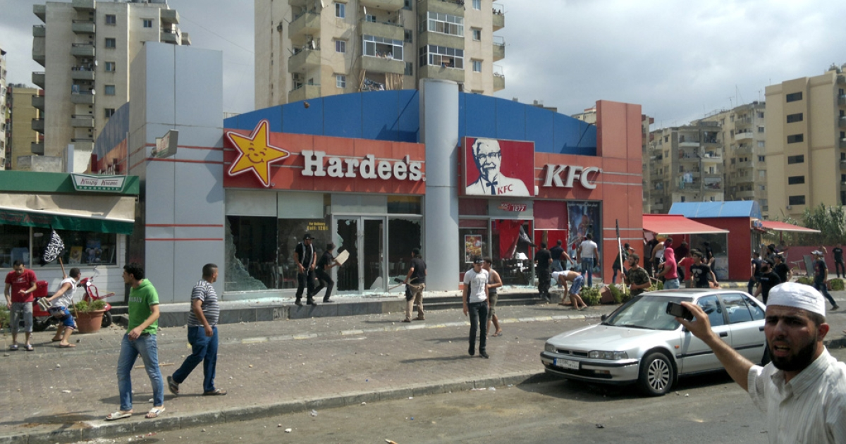 Men ransack US fast food chains Hardee's, KFC and Krispy Kreme as they protest against the controversial film