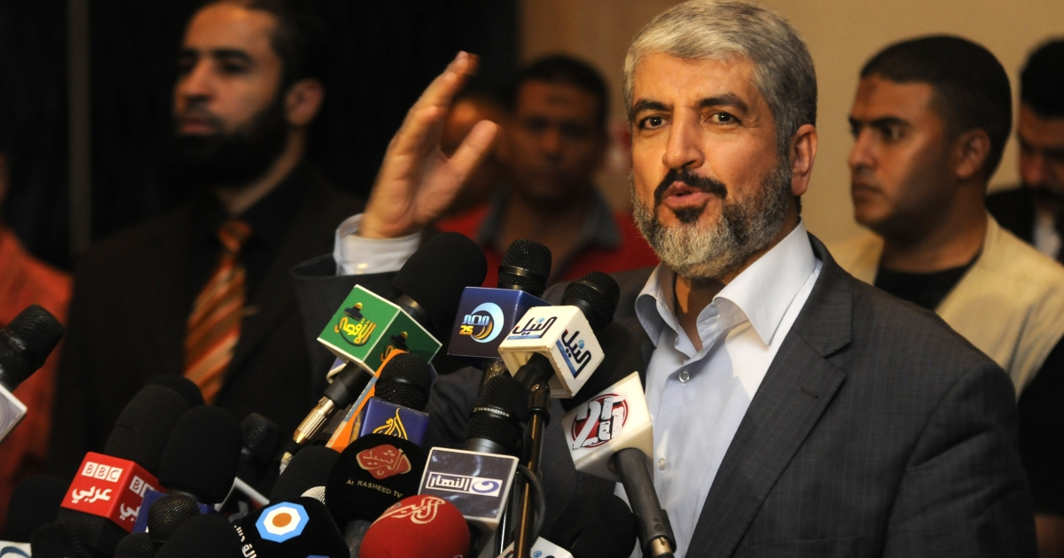 Exiled Palestinian Hamas leader Khaled Meshaal addresses a meeting in Cairo with some 40 Palestinian prisoners who were freed by Israel but were to be deported overseas in October.</p>