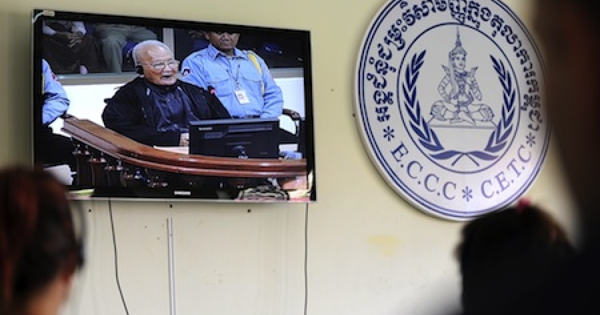 Cambodian and foreign journalists listen to former Khmer Rouge leader 'Brother Number Two' Nuon Chea speaking during a live feed video at ongoing Khmer Rouge war crimes tribunals.</p>