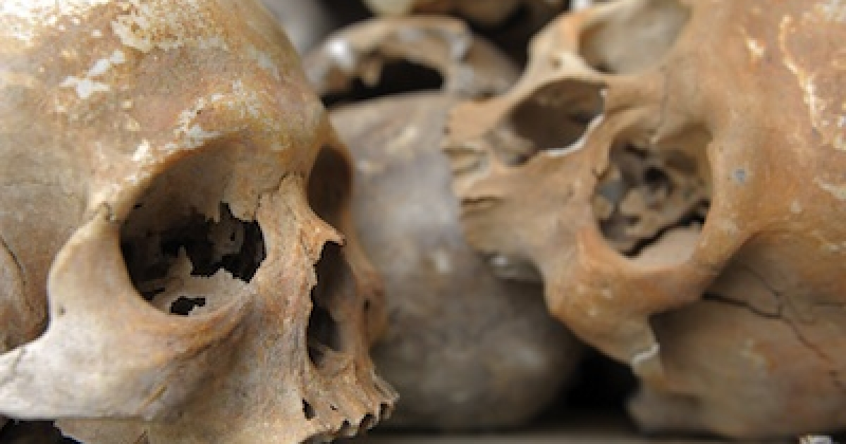 Skulls of Khmer Rouge victims are displayed at the Choeung Ek killing fields memorial in Phnom Penh, Cambodia.</p>