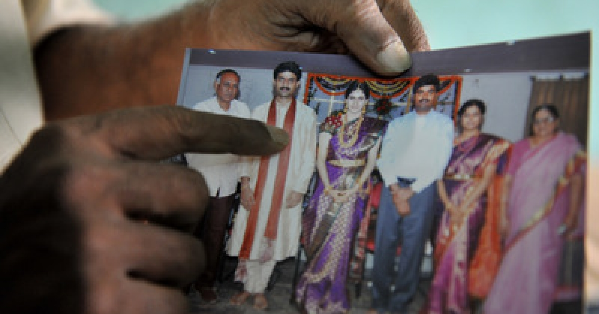Relative of abducted chief administrator of India's Orrissa state  R. Vineel Krishna, Y.Mohan Rao ,shows a family photograph featuring Krishna (2-L) at the family home in Hyderabad on February 17, 2011.   Maoist rebels in the eastern Indian state of Orissa have kidnapped a senior local official and demanded an end to security force operations in the area, police said. R. Vineel Krishna, chief administrator of the insurgency-hit Malkanagiri district, and one of his aides were taken hostage on February 16, 2011 night some 620 kilometres (380 miles) south of the state capital Bhubaneswar.</p>