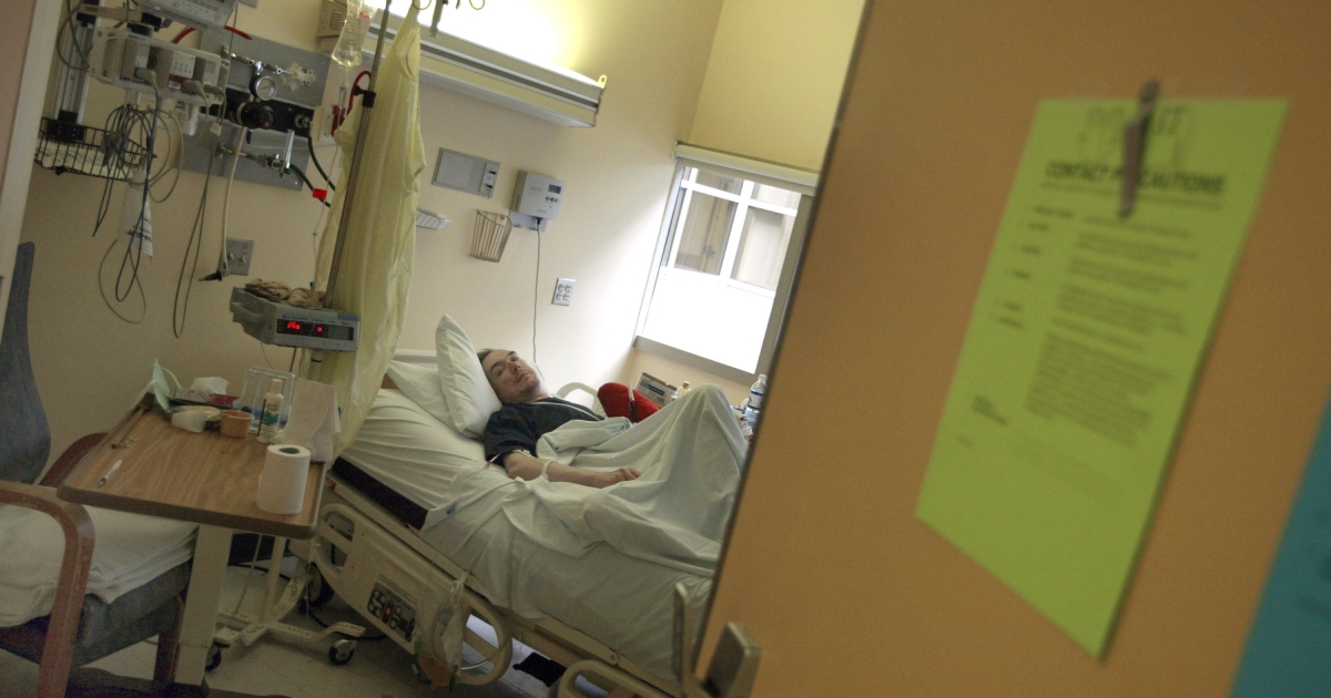A man rests in his hospital room at the University of Chicago after kidney, liver and lung transplants.</p>