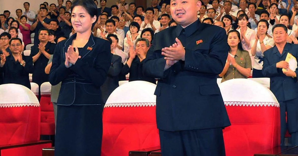 North Korean leader Kim Jong Un (center) enjoys a performance in Pyongyang with a young woman (left), likely his wife Ri Sol Ju. The photo was taken on July 6, 2012, by North Korean official Korean Central News Agency.</p>