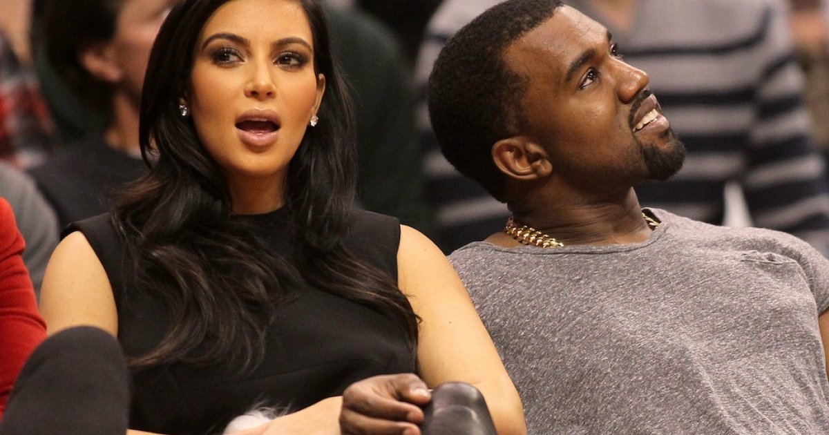 Kim Kardashian and Kanye West attend the NBA game between the Denver Nuggets and the Los Angeles Clippers at Staples Center on Dec. 25, 2012 in Los Angeles, California.</p>