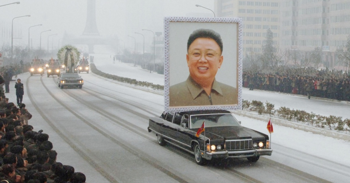 In this photo taken on December 28, 2011, a car carries a portrait of Kim Jong Il during the funeral procession in Pyongyang.</p>