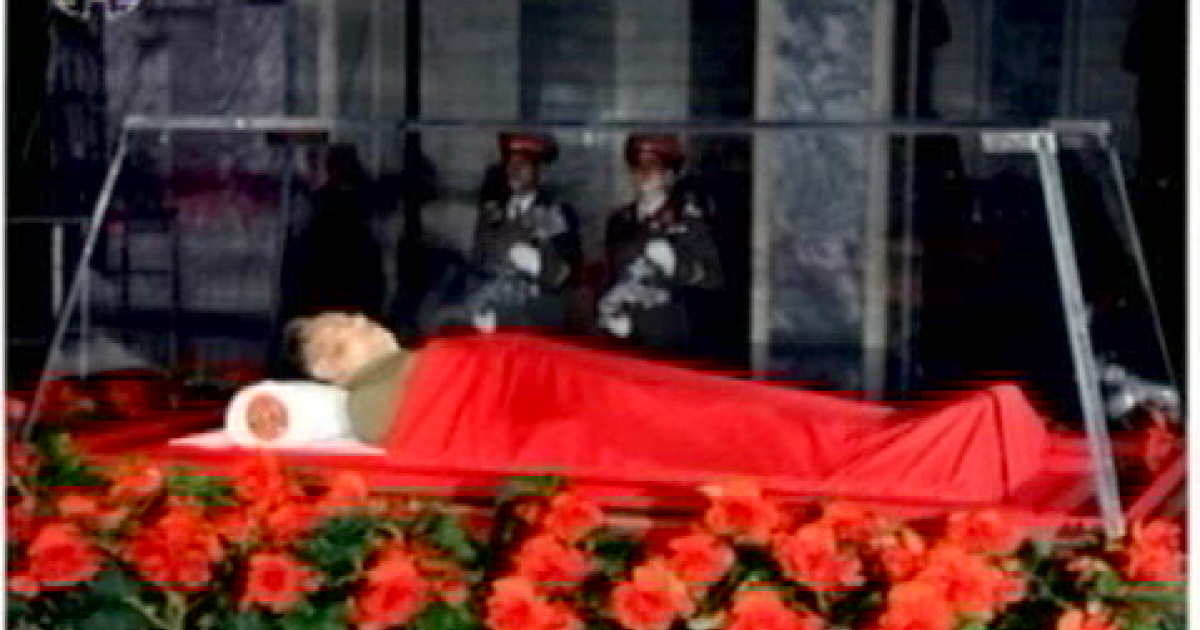 North Korea's state TV network broadcasts images of deceased ruler Kim Jong Il on a ceremonial platform.</p>
