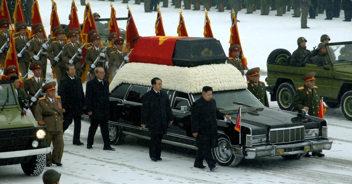 This handout picture taken by North Korea's official Korean Central News Agency (KCNA) on December 28, 2011, shows Kim Jong Un (center R) and Jang Song-Thaek (C) besides the convoy carrying the body of Kim's father and late leader Kim Jong Il at Kumsusan Memorial Palace in Pyongyang.</p>