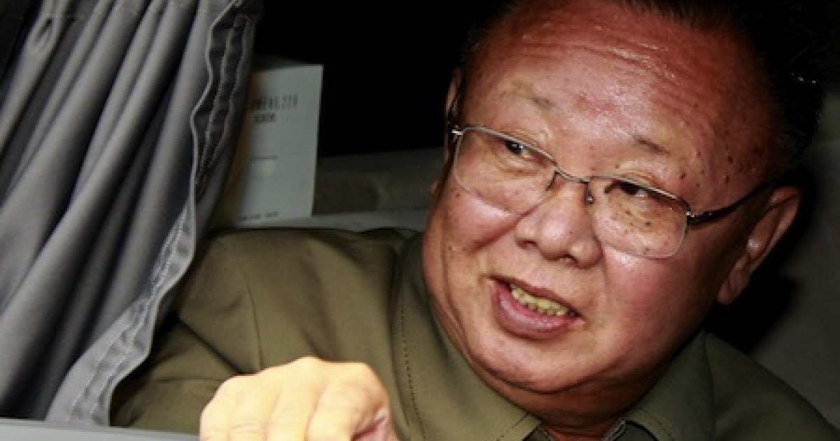 North Korea's leader Kim Jong-Il peers out of a car window after a meeting with Russian officials on August 24, 2011.</p>