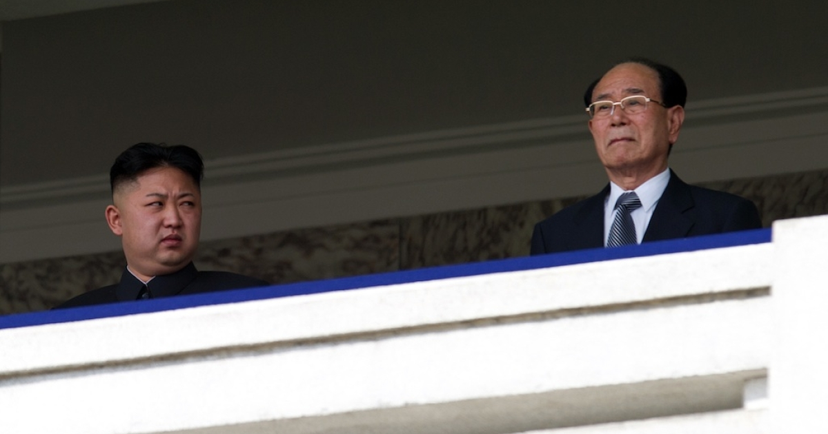 North Korean leader Kim Jong-Un (L) looks at President of the Presidium of the Supreme People's Assembly of North Korea Kim Yong-nam (R) during a military parade. There are unconfirmed rumors about Kim Jong Un's plans for his government.</p>