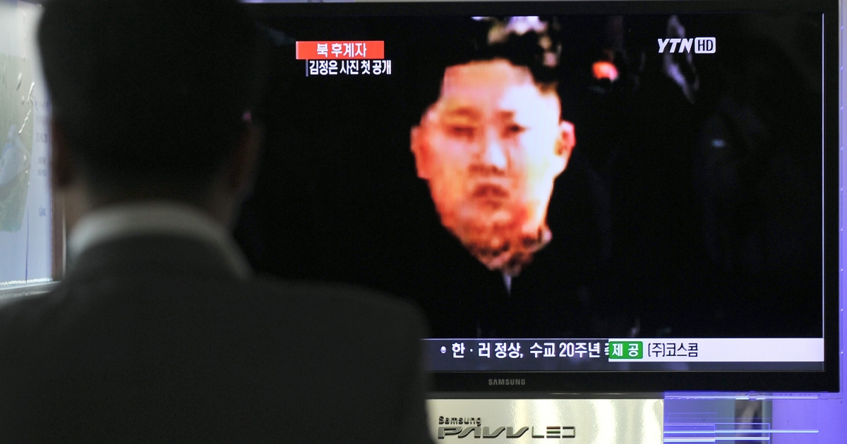 A man watches a TV showing a close-up of Kim Jong Un, in Seoul, South Korea, September 30, 2010.</p>