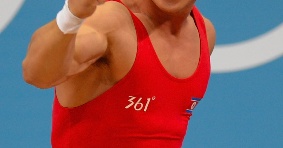 Un Guk Kim of North Korea celebrates while competing in the men's 62kg weightlifting on day three of the London 2012 Olympic Games, July 30, 2012.</p>
