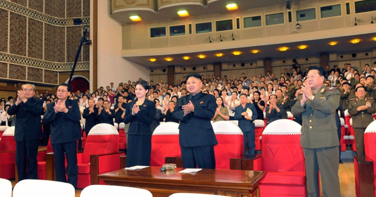 This picture, taken on July 6, 2012 by North Korean official Korean Central News Agency and released on July 9, shows North Korean leader Kim Jong Un (C), accompanied by a young woman, enjoying a demonstration performance given by the newly organized Moranbong band in Pyongyang.</p>