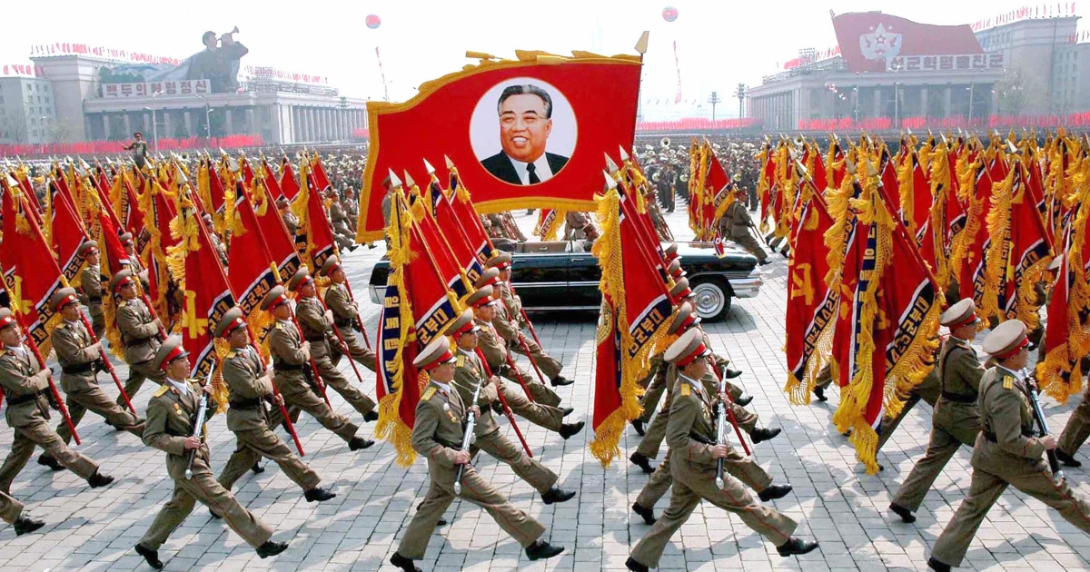 his 25 April 2007 picture, released from Korean Central News Agency 26 April, shows North Korean soldiers, carrying a large portrait of late North Korean leader Kim Il Sung, marching during a grand military parade to celebrate the 75th founding anniversary of the KPA at the Kim Il Sung square in Pyongyang.</p>