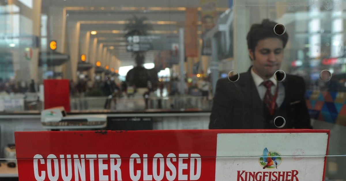 In this photograph taken on October 20, 2012, an Indian customer service representative stands inside the closed window of a Kingfisher Airlines booking counter at the International airport in New Delhi. India's troubled Kingfisher Airlines, which has been grounded since October, posted a record second-quarter loss on November 8, 2012, as revenues crashed, intensifying concerns about the carrier's future.</p>