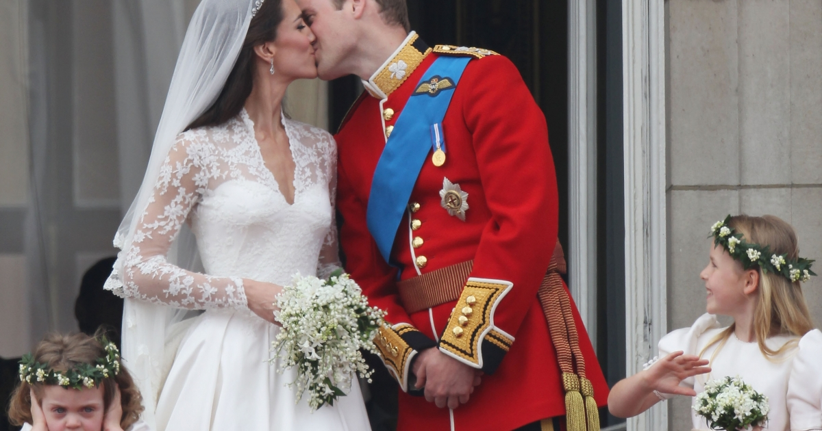 William and Kate, the presumptive future monarchs of the United Kingdom, kiss in front of thousands of cheering fans who flocked to Buckingham Palace in April 2011 to wish the newlywed couple well. Not everyone in attendance was jubilant, however; it seems that 3-year old bridesmaid, Grace Van Cutsem, was a little grumpy that day.</p>