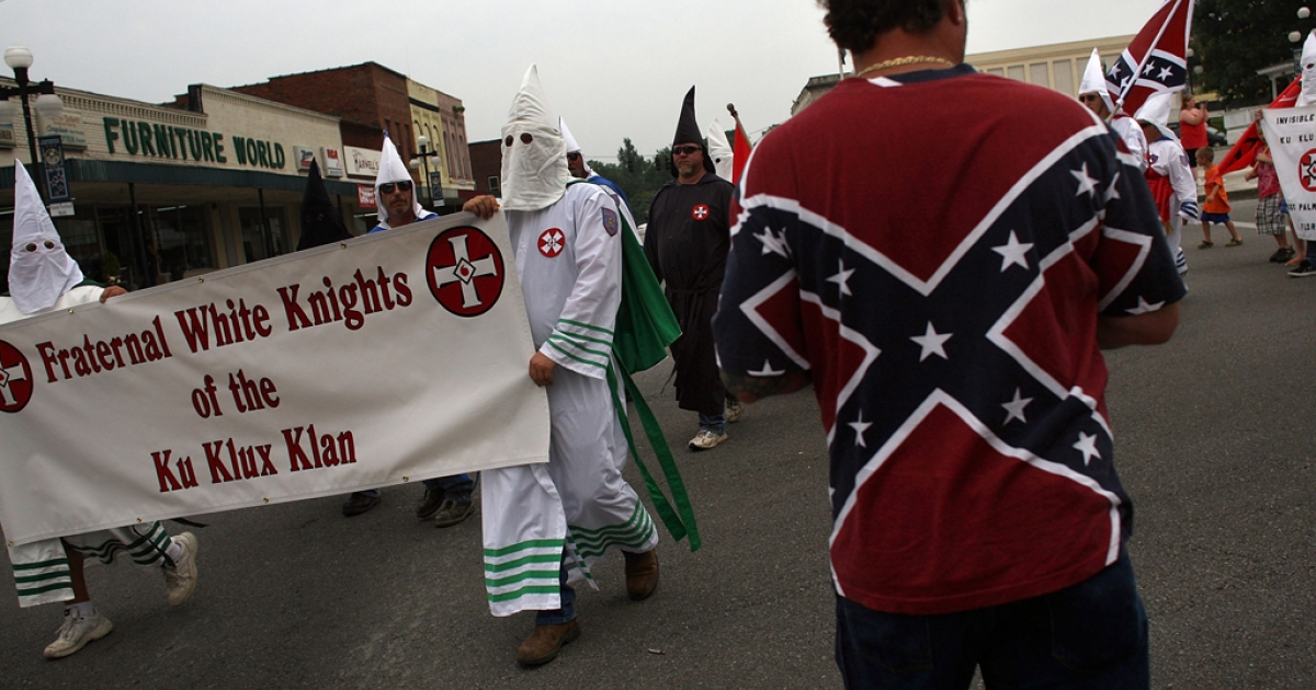 Members of the Fraternal White Knights of the Ku Klux Klan march in Tennessee. The number of hate groups in the US has risen for the third consecutive year.</p>
