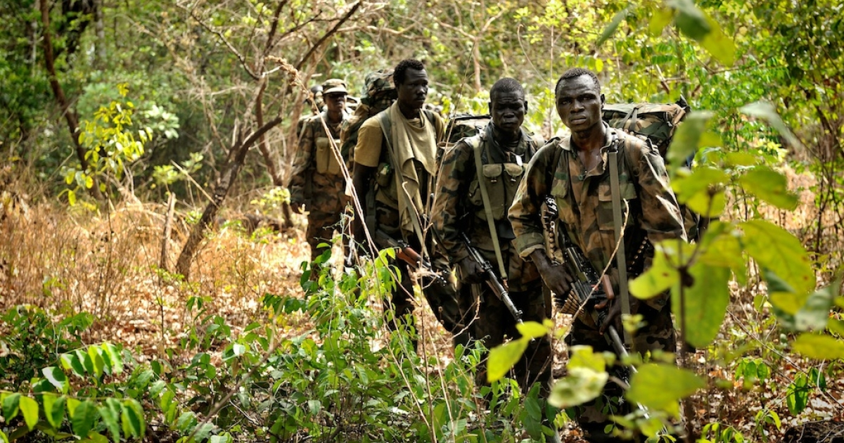Ugandan soldiers patrol the central African jungle during an operation to hunt the notorious Lord's Resistance Army (LRA) leader Joseph Kony. The unit is one of several dozen Ugandan army search squads, advised since late last year by 100 American special forces troops, searching for any traces of the brutal rebel group in an inhospitable 250-mile stretch in the far eastern corner of the Central African Republic.</p>