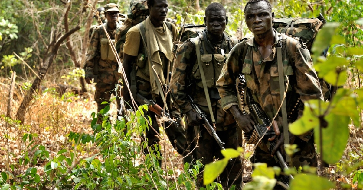 Ugandan soldiers patrol through the central African jungle during the hunt for notorious Lord's Resistance Army leader Joseph Kony.</p>