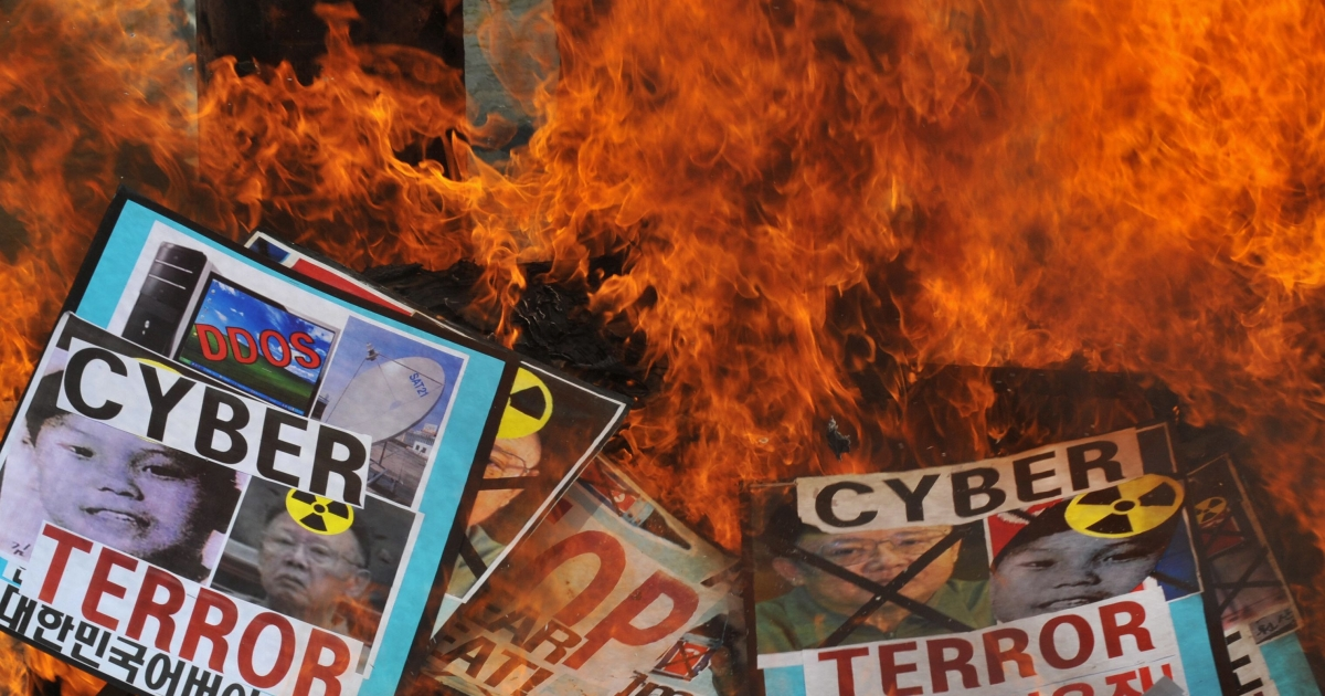 South Korean conservative activists burn placards containing images of North Korean leader Kim Jong-Iland his son Kim Jong-Un during an anti-North Korean rally in Seoul on July 10, 2009. The activists were denouncing the North's cyber attacks and demanding a release of US female journalists detained by the North.</p>