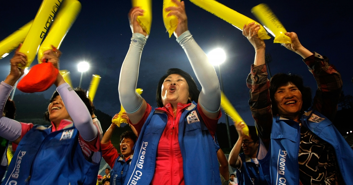 South Koreans celebrate after obtaining a first-round majority in the vote for Pyeongchang to host the 2018 Winter Olympics.</p>