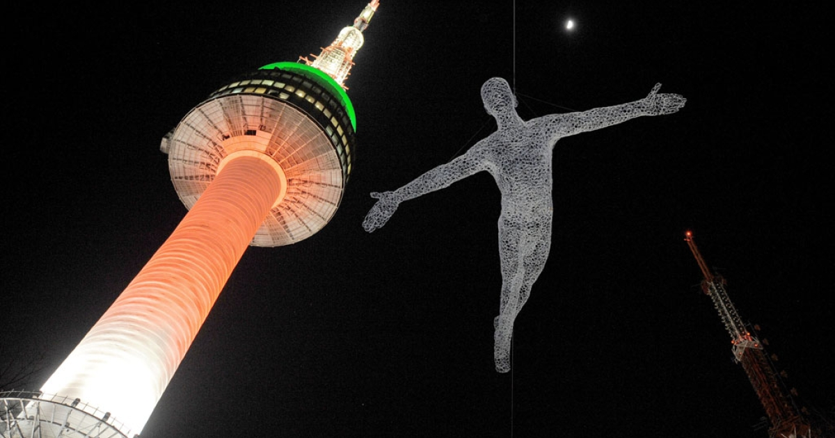 A work of art is in the air next to the North Seoul Tower on the top of Nam mountain in Seoul on Feb, 22, 2010. The tower is the best observatory space of Seoul.</p>