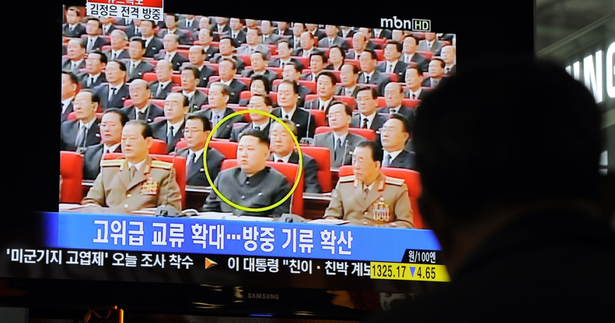 A South Korean man watches a TV newscast reporting the visit to China by North Korea's Kim Jong Un on May 20, 2011.</p>