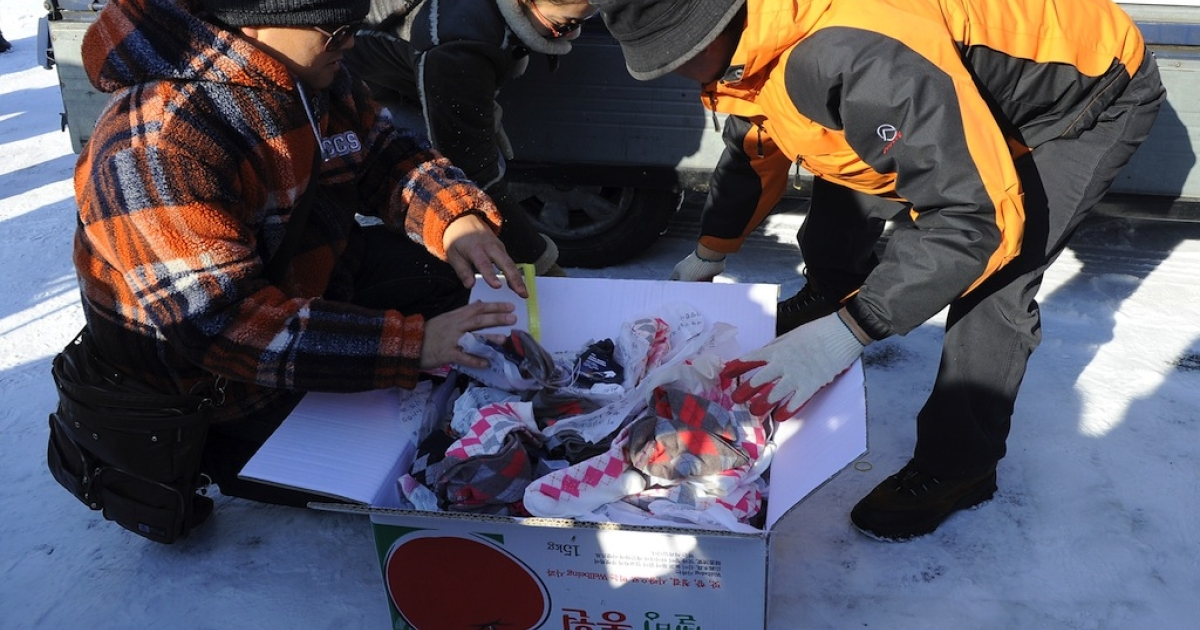 Using gas-filled ballones, socks and a leaflet reading, 'We, from all countries, love you' were sent from South Korea to a place in North Korea where people can exchange socks for food on Dec. 24, 2011.</p>