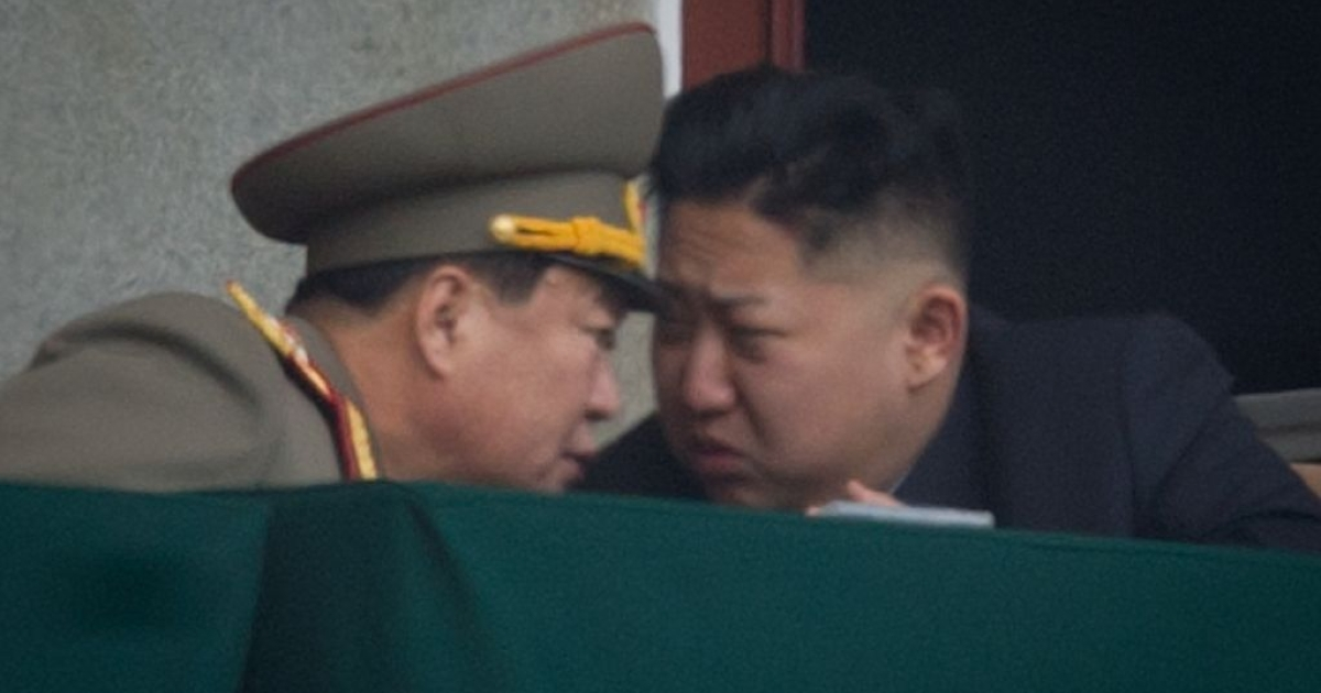 North Korea's leader Kim Jong-Un (R) talks to a military aide during an official ceremony at the Kim Il-Sung stadium in Pyongyang on Apr. 14, 2012. North Korea will mark the 100th birthday of its founder Kim Il-Sung on Apr. 15.</p>