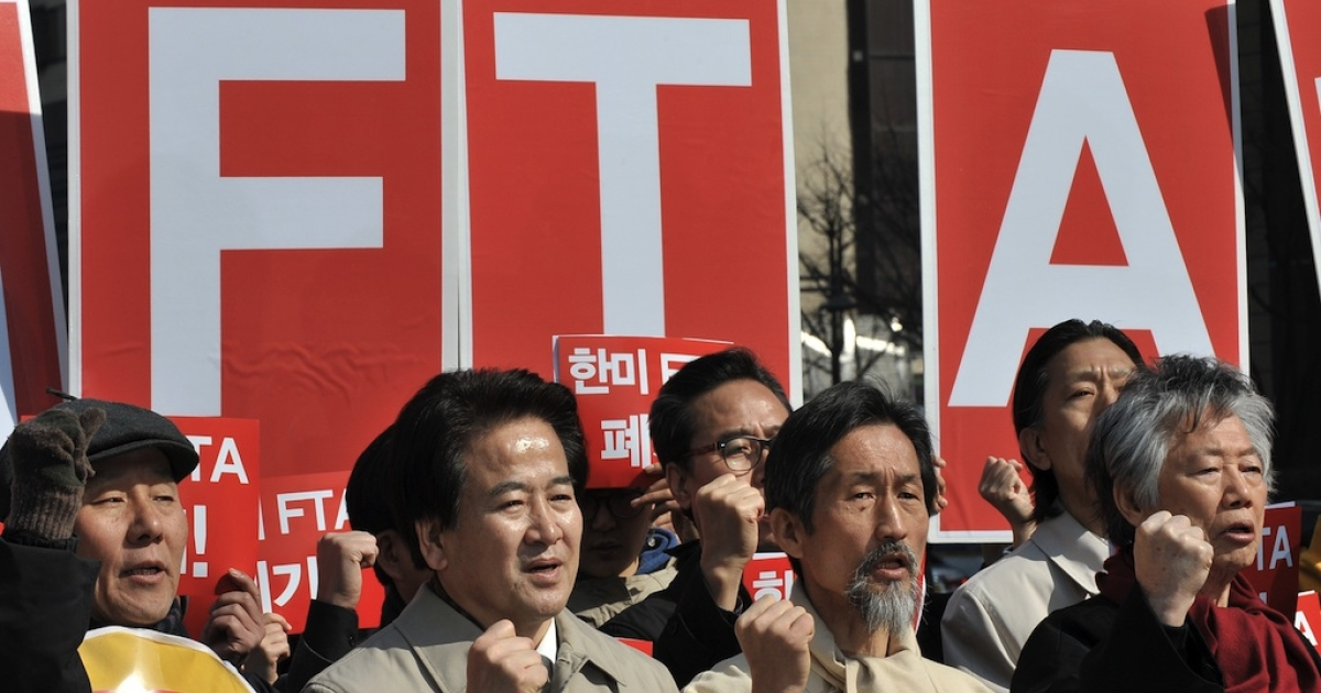 South Korea's opposition party lawmakers and activists shout slogans during a rally against a South Korea-US free trade agreement in Seoul on March 15, 2012. A long-delayed free trade agreement between the US and South Korea took effect amid praises from their leaders but also sparking scattered protests. The protestors said the agreement would only 'make the rich richer and the poor poorer,' devastate the country's weak agriculture and service industry and sacrifice most of the people only to benefit large businesses.</p>