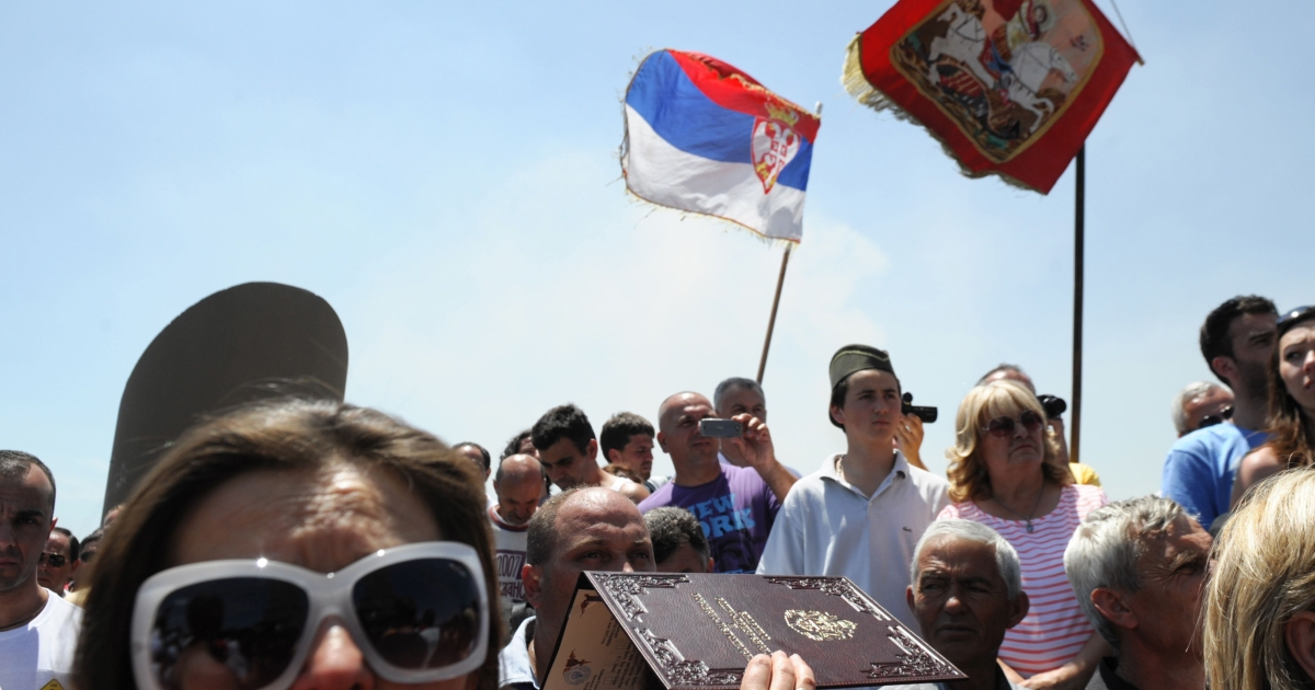 Serbia's residents attend a rally marking a historic battle at Gazimestan, near Pristina on June 28, 2012.</p>