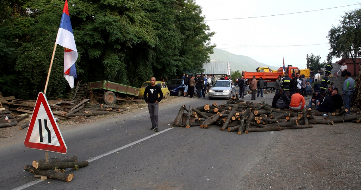 Kosovo Serbs setup a blockade on the Leposavic-Mitrovica road as a response to the capturing of two border crossings by Kosovo police, who seek to enforce an embargo of Serbian goods, near Leposavic, on July 26, 2011.</p>