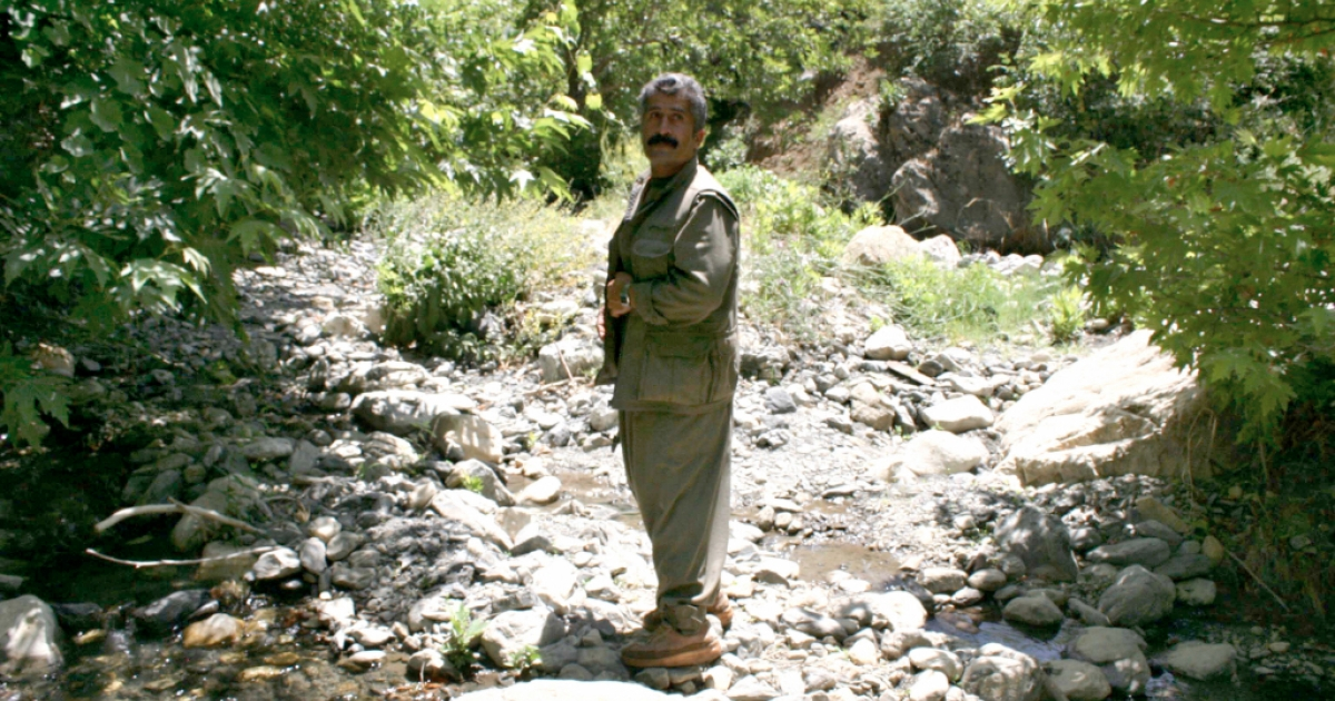 Aso Honer, leader of the Party of Free Life of Kurdistan, stands by a mountain stream in the northern region of Qandil in Kurdistan on June 14, 2008.</p>
