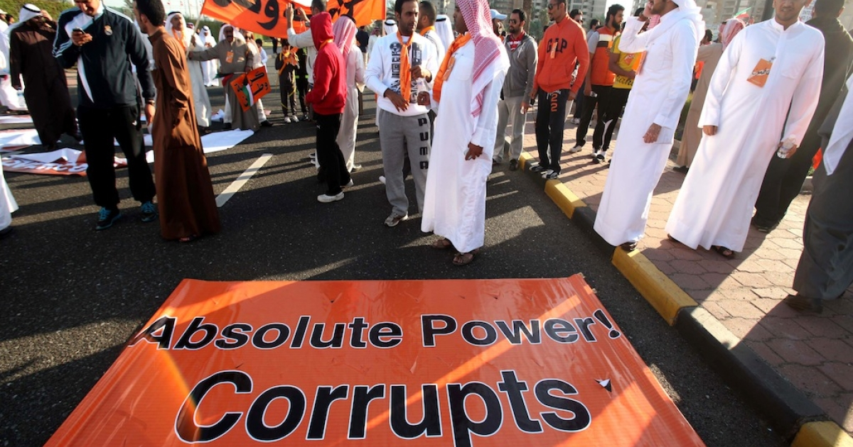 Kuwaiti opposition supporters block a major road in Kuwait City on November 30, 2012, during a demonstration against a decision by Emir Sheikh Sabah al-Ahmad al-Sabah to amend the electoral law. The regime has been harsher on activists lately, and has begun jailing outspoken Twitter users and internet activists.</p>