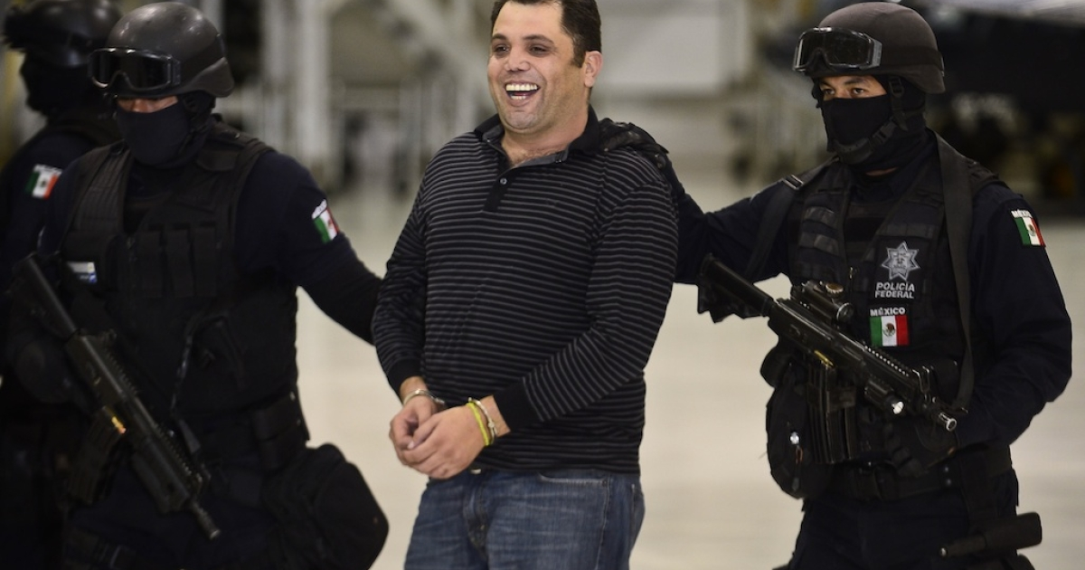 Ramiro Pozos Gonzalez, the suspected leader of La Resistencia gang, is paraded in front of the Mexican media today.</p>