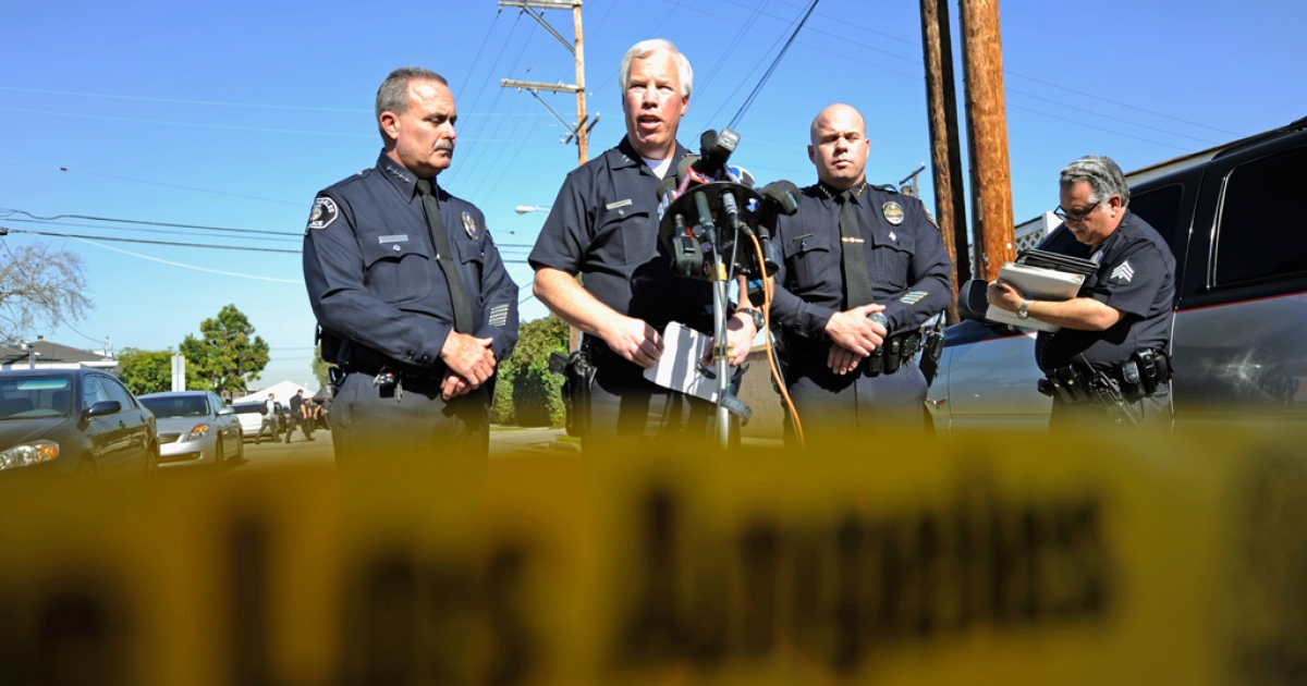 Los Angeles Police Department Deputy Chief Patrick Gannon (2nd L), Los Angeles Unified School District's Steve Zipperman (2nd R) and Gardena Police Chief Ed Medrano (L) hold a news conference. The LAPD and LAUSD district officials are closing Miramonte Elementary School this week to investigate allegations of sexual abuse.</p>