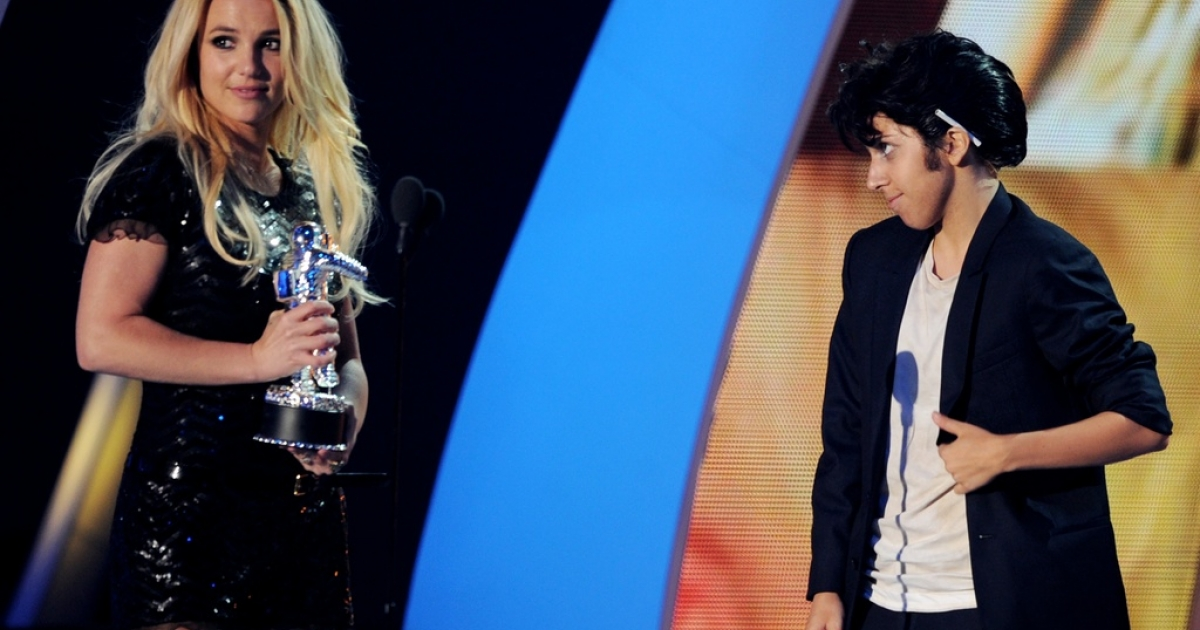 Pop star Lady Gaga, shown here dressed as a man, is one reason America is the coolest. Pop star Britney Spears, left, is not.</p>
