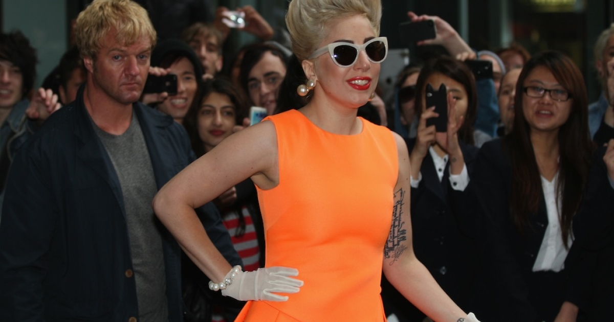 Lady Gaga, greets fans as she arrives at the Stamford Plaza on June 5, 2012 in Auckland, New Zealand</p>